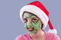 Funny face paint and Santa hat. Royalty Free Stock Photography