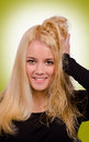 Funny face portrait with blond girl at the barber shop Stock Image