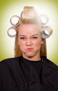 Funny face portrait with blond girl at the barber shop Royalty Free Stock Photo