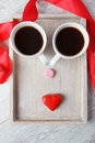 Funny face on the wooden tray made with coffee cups and candies Stock Image