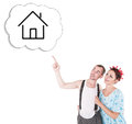 Funny family couple embracing and pointing on dream house Royalty Free Stock Photo