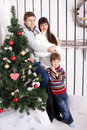 Funny family near the christmas tree new year holiday concept Stock Photography