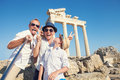 Funny family take a selfie photo on apollo temple colonnade view in side turkey by creativephototeam com Stock Images