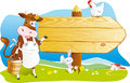 Funny farm animals wooden signboard copy space cute cartoon cow with milk rabbit and hen pointing for text countryside landscape Stock Photography