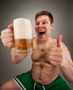 Funny fat man drinking beer Royalty Free Stock Photography