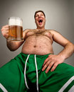 Funny fat man with glass of beer Royalty Free Stock Photo