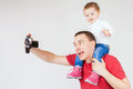 Funny father and child making selfie at vintage camera image of old family white background fashion baby looking hobby Royalty Free Stock Photos
