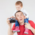 Funny father and child making selfie at vintage camera image of old family white background fashion baby looking hobby Stock Photos