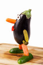 Funny figure carved out of an aubergine Royalty Free Stock Photo