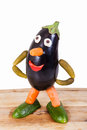 Funny figure carved out of an eggplant Royalty Free Stock Photo
