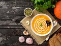 Funny food for Halloween. Pumpkin puree soup, spider web, dark old wooden table, top view, copy space Royalty Free Stock Photo