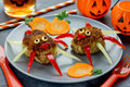Funny food idea for kids spider meatballs with pumpkin slice Royalty Free Stock Photo