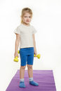 Funny four-year girl with dumbbells Royalty Free Stock Photo