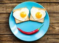 Funny fried eggs for the breakfast with love Royalty Free Stock Photography