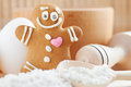 Funny gingerbread man flour rolling pin spoon and egg on kitchen table Royalty Free Stock Photo
