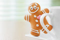 Funny gingerbread man peeking out mugs Royalty Free Stock Image