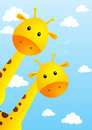Funny giraffes on sky background Royalty Free Stock Photography