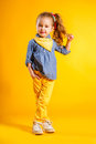 Funny girl on bright yellow background. Royalty Free Stock Photo