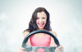Funny girl with car wheel and smoke Royalty Free Stock Photo