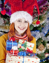 Funny girl in christmas cap with gift boxes Royalty Free Stock Photography