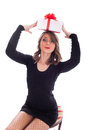 Funny girl with christmas present above head sexy holding a the Stock Photography