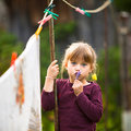 Funny girl with clothespin and the clothesline. Stock Image