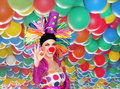 Funny girl clown with a big colorful wig saying Ok Royalty Free Stock Photos