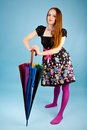 Funny girl with colorful umbrella Stock Photo