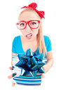 Funny girl disappointed with a gift Royalty Free Stock Images