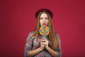 Funny girl eating big striped lollipop Royalty Free Stock Photo
