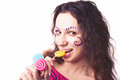 Funny girl eating lollipop Stock Image
