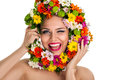 Funny girl with flower wreath holding winking and laughing Stock Photos