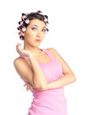 Funny girl with hair curlers on her head Stock Image