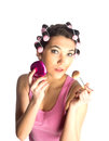 Funny girl with hair curlers on her head Royalty Free Stock Images