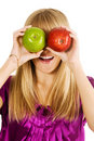Funny girl holding two apples Stock Images