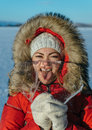 Funny girl with an icicle. Royalty Free Stock Photo