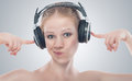 Funny girl listening to music on headphones