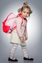 Funny girl little with backpack Stock Photos