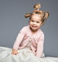 Funny girl little having fun on bed Stock Image