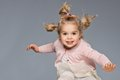 Funny girl little having fun jumping Stock Photo