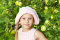 Funny girl next to the apple tree Royalty Free Stock Image