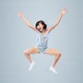 Funny girl in pajamas jumping for joy caucasian Stock Image