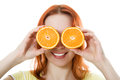Funny girl portrait, holding oranges over eyes Royalty Free Stock Photography