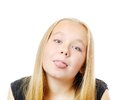 Funny girl pretty sticking her tongue out isolated on while Royalty Free Stock Images