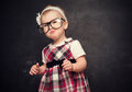 Funny girl pupil in glasses at blackboard baby Royalty Free Stock Photography
