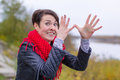 Funny girl in red scarf oudoor autumn day Stock Photo