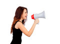 Funny girl shouting with a megaphone isolated on white background Royalty Free Stock Photo