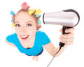 Funny girl styling hair Royalty Free Stock Photos