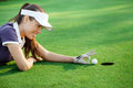 Funny golf female golfer flick the ball into the hole Stock Photography