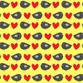 Funny gray birdies with red hearts on a yellow background. Colorful seamless pattern for children.